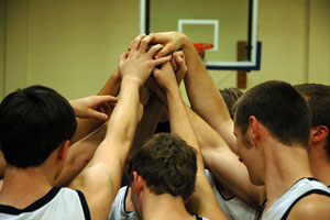 basketball team in a huddle
